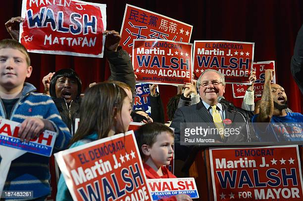 Boston Mayor Elect Marty Walsh is introduced by Massachusetts Speaker of the House of Representatives Robert DeLeo on Election Eve at a campaign...