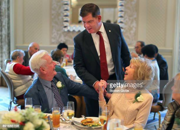 Boston Mayor Martin J Walsh greets Bill and Ann Downey who have been married for 60 years during the annual Boston Elderly Commission Golden Wedding...
