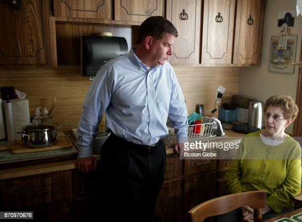 Boston Mayor Martin J Walsh left stands with his mother Mary Walsh in his childhood home on Taft Street in the Dorchester neighborhood of Boston on...