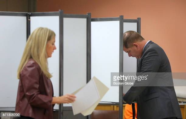 Boston Mayor Martin J Walsh right and his partner Lorrie Higgins left vote at the Lower Mills Branch of the Boston Public Library in Boston Nov 7 2017