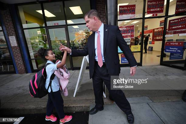 Boston Mayor Martin J Walsh says hello to 10yearold Mari Bobadilla after he was endorsed for reelection by the Dominican American Coalition at his...
