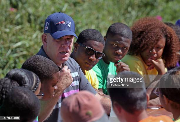 Boston Mayor Martin J Walsh visits to teach a civics class to a group of 1518yearolds who have been deemed 'Leaders in Training' at Camp Harbor View...