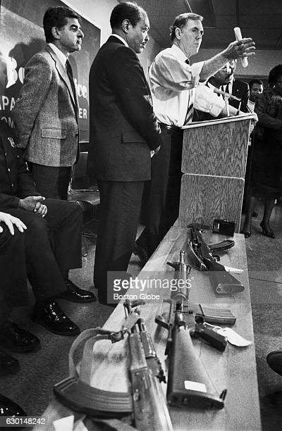 Boston Mayor Ray Flynn right speaks at a police station in Boston December 1989 Governor Michael Dukakis of Mass left signed a statewide assault...