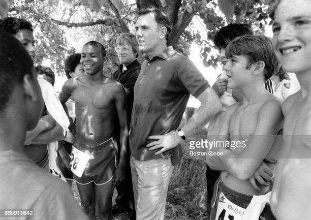 Boston Mayor Ray Flynn talks with participants in a Youth Olympics event at Columbia Park in South Boston on Jun 10 1984