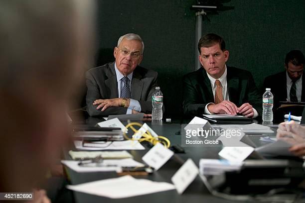 Boston Mayor Tom Menino left listened to Barbara Ferrer Director of the Boston Public Health Commission foreground left alongside MayorElect Martin...