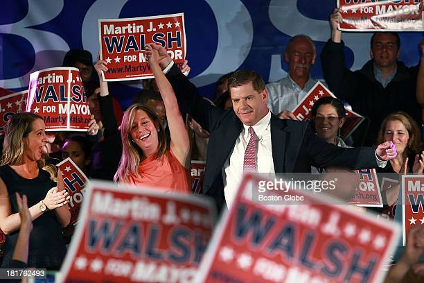 Boston mayoral candidate Martin Walsh celebrates with Lorrie Higgins and her daughter far left at his victory party held at the Venezia Restaurant in...