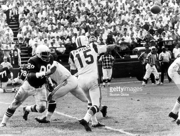 Boston Patriots quarterback Babe Parilli throws a pass during a game at Fenway Park in Boston on Sept 11 1965