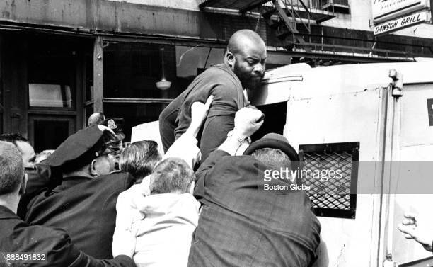 Boston Police arrest demonstrators including Melvin H King director of the Urban League during a protest organized by the Community Assembly for a...