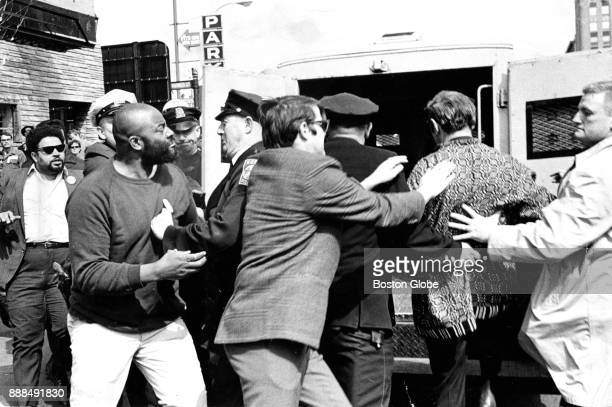 Boston Police arrest demonstrators including Melvin H King left director of the Urban League during a protest organized by the Community Assembly for...