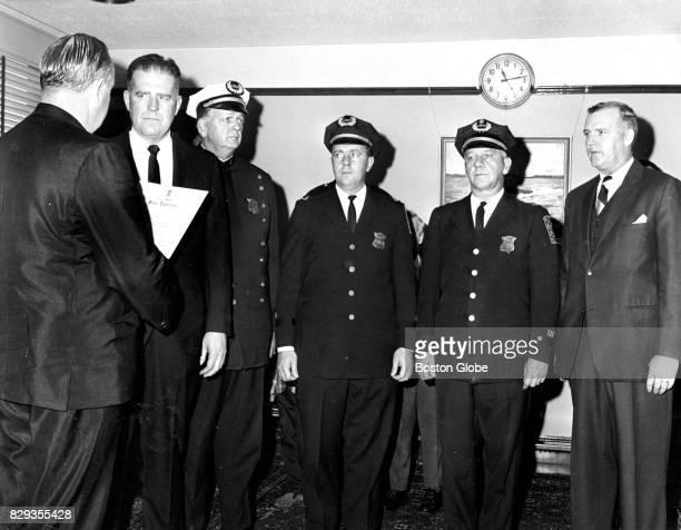 Boston Police Commissioner Edmund McNamara far left is pictured with Deputy Superintendent John J Donovan Deputy Superintendent John F Brennan...