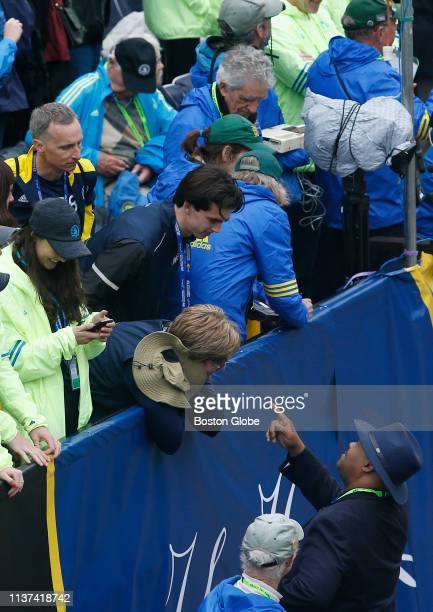 Boston Police Commissioner William Gross greets the family of 2013 Boston Marathon bombing victim Martin Richard at the finish line of the 123rd...