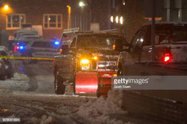 Boston Police investigate the scene where a snow plow ranover a woman near Tuft's Medical Center as another major nor'easter barrels Into...
