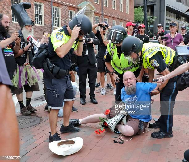 Boston Police make an arrest outside the Straight Pride Parade in Boston on Aug 31 2019 In dueling demonstrations about a mile apart a Straight Pride...