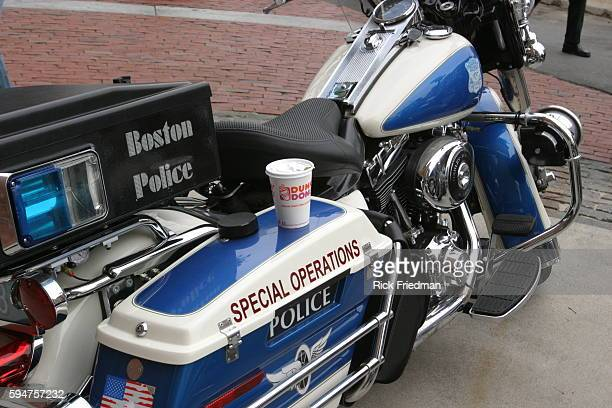 A Boston police officer leaves his Dunkin Donuts coffee on his motorcycle