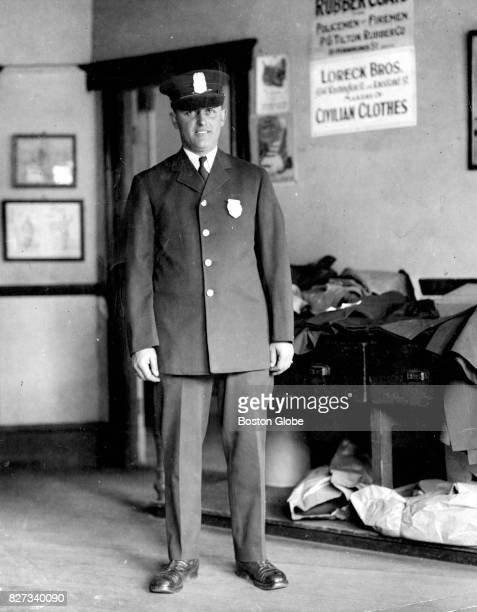 Boston police officer models the department's new uniform which features a visible necktie circa May 1929