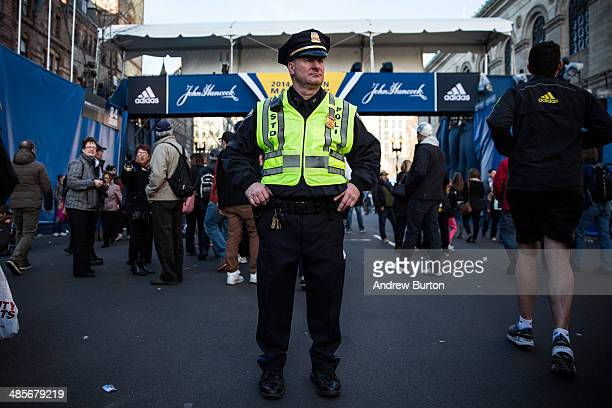 Boston police officer stands guard near the finish line of the Boston Marathon on April 19 2014 in Boston Massachusetts This year's marathon will be...
