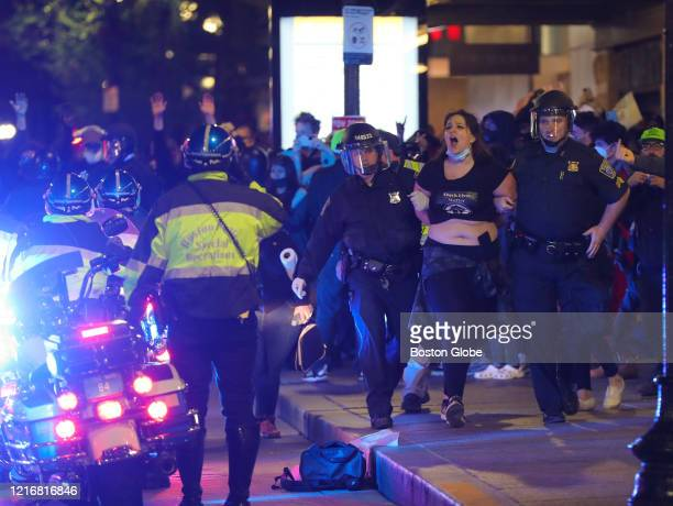 Boston Police Officers arrest a protester in Downtown Crossing in Boston on May 31 2020 Violent protests erupted late at night after a day of...