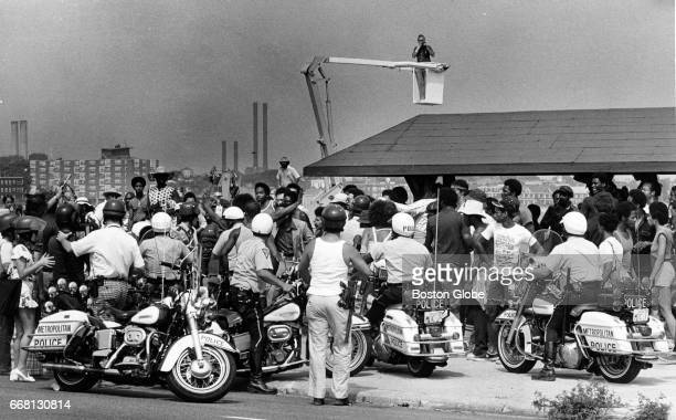 Boston police officers face off against a crowd at Carson Beach in South Boston on Aug 10 1975 Hundreds of officers were on hand to quell a...