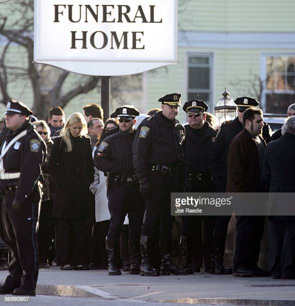 Boston Police officers line up with mourners to pay their respects during a wake at the Gormley Funeral Home for Imette St Guillen on March 3 2006 in...