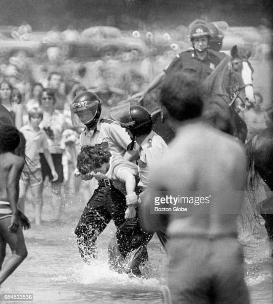 Boston police officers make an arrest at Carson Beach in South Boston on Jul 31 1977 The area had been the scene of a number of recent...