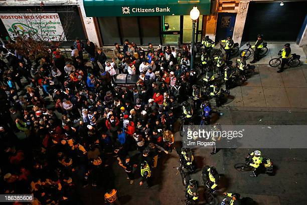 Boston Police officers move fans away from Fenway Park during Game Six of the 2013 World Series between the Boston Red Sox and the St Louis Cardinals...