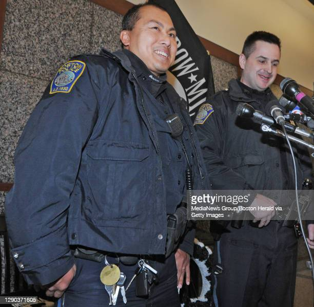 Boston Police Officers Thuan Lai and Vladimir Levichev smile while speaking with media on Tuesday,January 12, 2016 at Boston Police Headquarters. The...