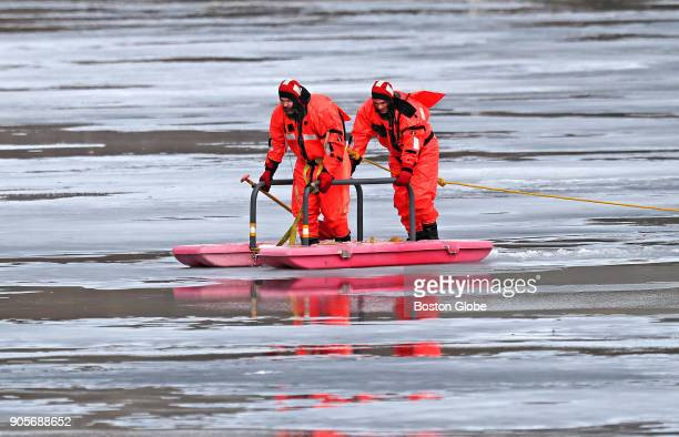 Boston Police on a pontoon raft search Jamaica Pond in response to a report that an individual had fallen through the ice on Jan 12 2018 A bicycle...