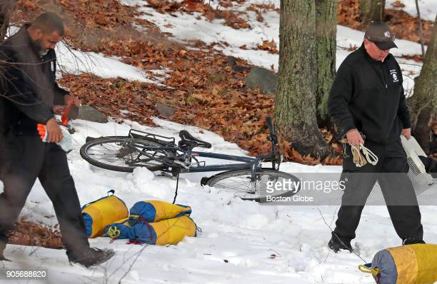 Boston Police pass a bicycle left on the shoreline of Jamaica Pond as they conduct a search in response to a report that an individual had failed...