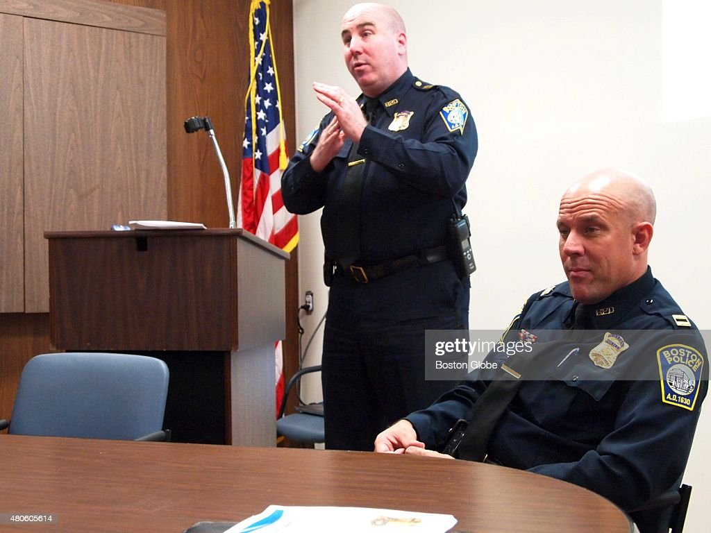 Boston Police Superintendent-in-Chief Daniel Linskey (standing) and District E-18 commander, Capt. Robert W. Ciccolo, spoke at Monday's meeting of the Ross Field Neighborhood Crime Watch. Both encouraged residents to report any crime or suspicious activity by calling 911 or the anonymous tip line.