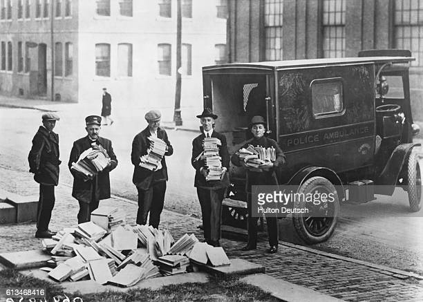 Boston Police with piles of communist literature which they have raided and banned as a precaution against their fear of revolution in America.
