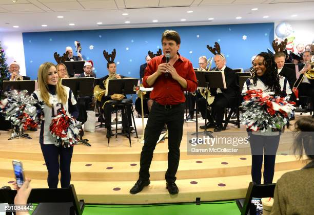 Boston Pops conductor Keith Lockhart with New England Patriots cheerleaders at the Boston Pops Holiday Concert at Boston Children's Hospital December...