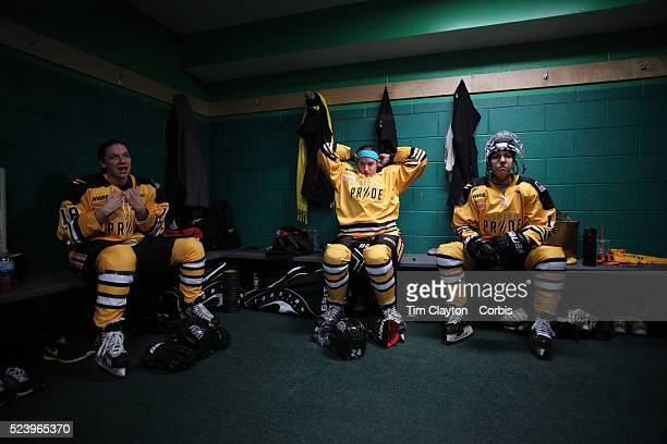 Boston Pride players, from left, Cherie Hendrickson, Denna Laing and Hayley Moore, prepare for the game in the dressing room before the Connecticut...
