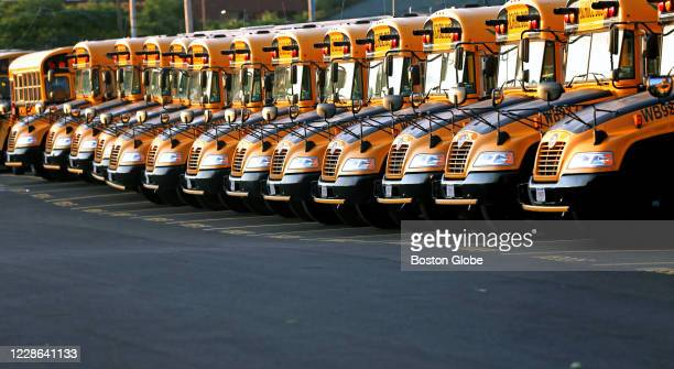 Boston public school busses parked at Freeport Street lot in Dorchester lay idle in the early morning for a Boston back to school during COVID-19...