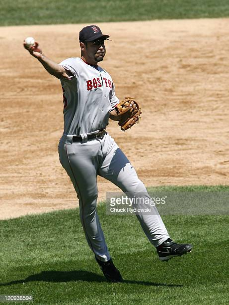 Boston Red Sox' 3B Mike Lowell makes an offbalance throw to get the hitter at first during the game against the Chicago White Sox July 9 2006 at US...