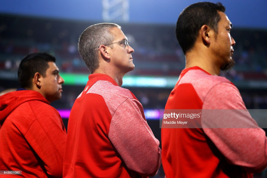 Boston Red Sox assistant athletic trainer Jon Jochim, center, looks on during the national anthem before the game against the Toronto Blue Jays at Fenway Park on September 6, 2017 in Boston, Massachusetts.