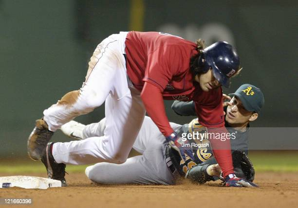 Boston Red Sox base runner Johnny Damon front collides with Oakland Athletics second baseman Marco Scutaro The Red Sox beat the A's 96 at Fenway Park...