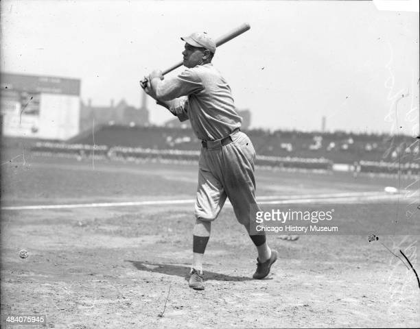 Boston Red Sox baseball player Babe Ruth following through after swinging a baseball bat at Comiskey Park Chicago Illinois 1918