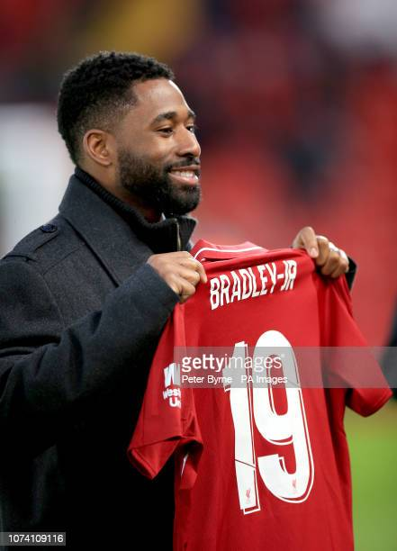 Boston Red Sox baseball player Jackie Bradley Jr with a personalised Liverpool shirt before the Premier League match at Anfield Liverpool