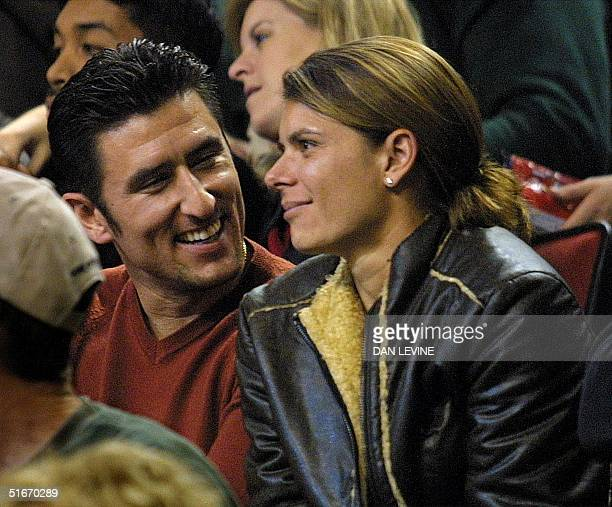 Boston Red Sox baseball player Nomar Garciaparra and US National Soccer Team star Mia Hamm attend the NBA game between the Seattle SuperSonics and...