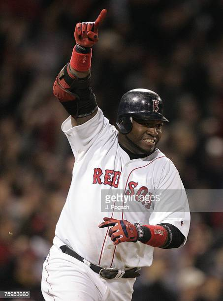 Boston Red Sox batter David Ortiz connects for a game-winning single in the 14th inning, which knocked in the winning run, against the New York...