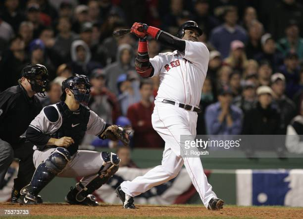 Boston Red Sox batter David Ortiz connects for a two-run home run in the 12th inning against the New York Yankees in Game Four of the American League...