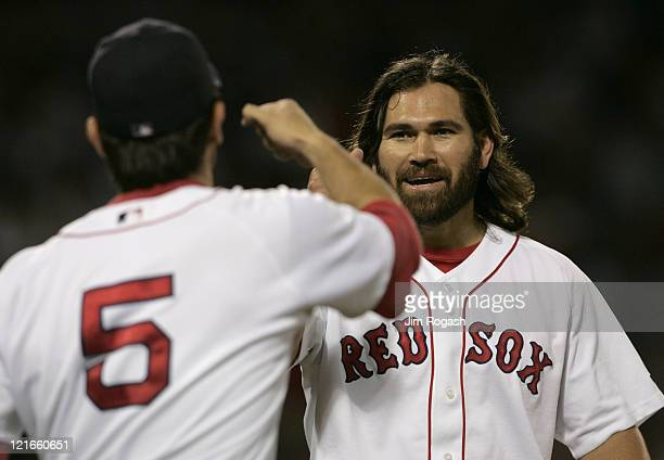 Boston Red Sox batter Johnny Damon right is congratulated by teammate Nomar Garciaparra after Damon collected a hit against the Texas Rangers Friday...