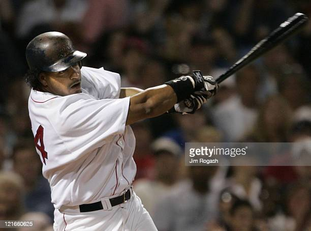 Boston Red Sox batter Manny Ramirez makes contact against the Texas Rangers Saturday July 10 2004 Ramirez hit two home runs in the game The Red Sox...