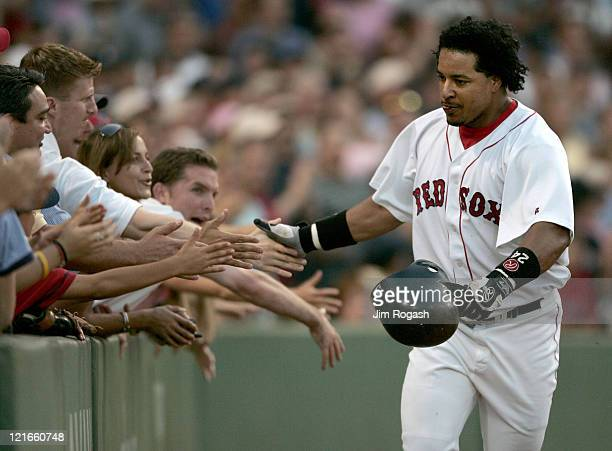Boston Red Sox batter Manny Ramirez touches the hands of fans after he hit the first of two home runs against Texas Rangers Saturday July 10 2004 The...