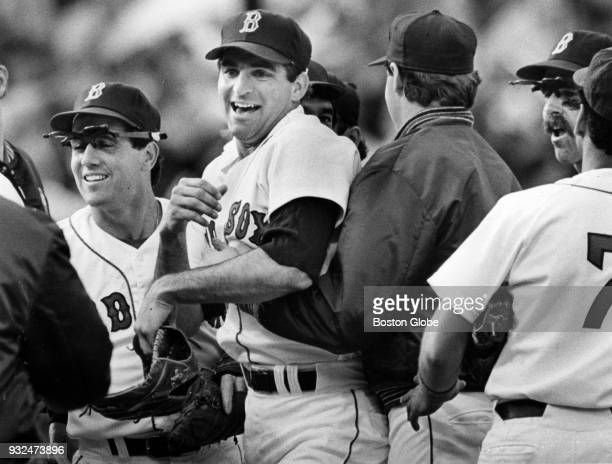 Boston Red Sox Bruce Hurst center congratulates teammates after the team beat the Toronto Blue Jays at Fenway Park in Boston Sept 27 1986