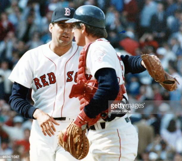 Boston Red Sox Bruce Hurst left and catcher Marc Sullivan right talk during a game against the Toronto Blue Jays at Fenway Park in Boston April 10...