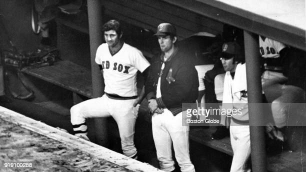 Boston Red Sox Carl Yastrzemski left and Bill Lee right watch the world series game from the dugout against the Cincinnati Reds at Fenway Park in...