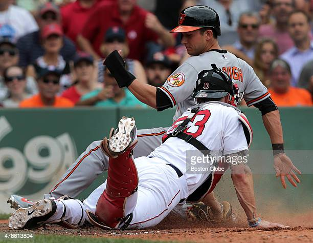 Boston Red Sox catcher Blake Swihart dives in time to put the tag out on Baltimore Orioles left fielder David Lough on a catch and throw out by...