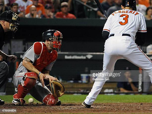Boston Red Sox catcher Blake Swihart left cannot handle a pitch from Matt Barnes to Baltimore Orioles batter Ryan Flaherty for a wild pitch allowing...