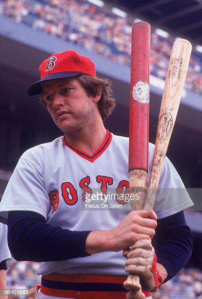 Boston Red Sox' catcher Carlton Fisk chews his tobacco and practices his swing during a game against the New York Yankees at Yankee Stadium circa the...